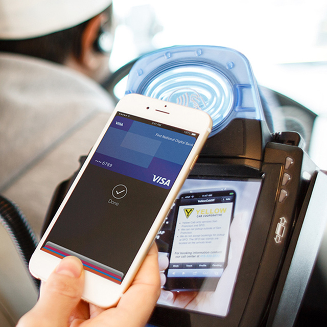 Paying cab fare using Visa with mobile phone at contactless-enabled terminal.