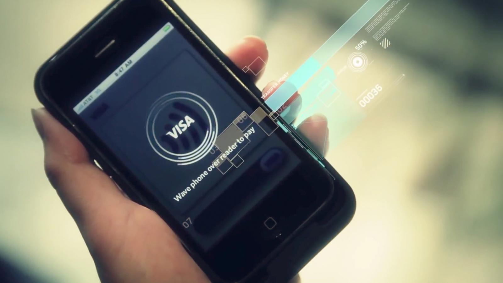 Closeup of a hand holding a smartphone displaying 'Visa' and the phrase 'Wave phone over reader.'