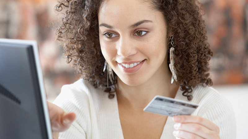 Woman paying online with card